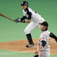 Big hit: The Fighters' Yoshio Itoi smacks a two-run double off Giants starter Tetsuya Utusmi in the third inning on Tuesday at Sapporo Dome. Hokkaido Nippon Ham beat Yomiuri 7-1. | KYODO PHOTO