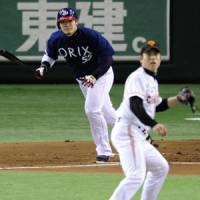 Busy shift: Takahiro Okada hits an RBI single for Orix in the first inning against the Giants on Sunday. | KYODO PHOTO