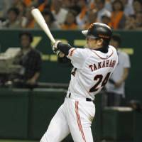 Clutch hit: The Giants' Yoshinobu Takahashi slugs a three-run homer in the seventh inning against the Fighters on Saturday at Tokyo Dome. Takahashi had two homers in Yomiuri's 6-5 win. | KYODO PHOTO