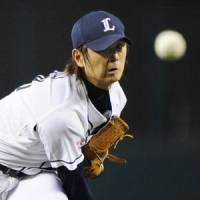 King of the jungle: Early struggles haven't stopped Lions ace Hideaki Wakui from establishing himself as one of the top hurlers in Japanese baseball this season. | KYODO PHOTO