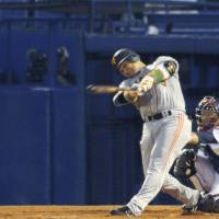 Big honor: Giants slugger Alex Ramirez smacks a leadoff home run in the fourth inning on Tuesday at Jingu Stadium. Yomiuri beat Tokyo Yakult 5-1. | KYODO PHOTO