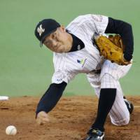 Complete job: Marines starter Shunsuke Watanabe pitches against the Hawks at Chiba Marine Stadium on Thursday. The submarine pitcher went the distance in the team's 7-2 win. | KYODO PHOTO