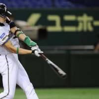 Fiery leader: Veteran Hichori Morimoto, seen hitting a three-run homer against the Hawks on Thursday, has helped the defending Pacific League champions rediscover their formula for winning in recent weeks. | KYODO PHOTO