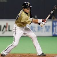 Pivotal play: Shinya Tsuruoka slaps a two-run single in the second inning against the Buffaloes on Saturday at Sapporo Dome. Hokkaido Nippon Ham defeated Orix 5-2. | KYODO PHOTO