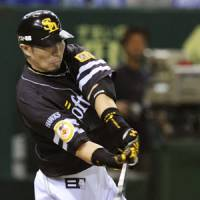 Flying high: Hitoshi Tamura has gotten off to a fast start for the Hawks this year. | KYODO PHOTO