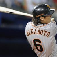 Yomiuri Giants shortstop Hayato Sakamoto connects for a two-run double in the eighth inning of Friday's game against the BayStars at Yokohama Stadium.