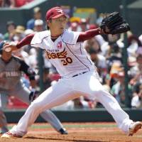 Sunday best: Tohoku Rakuten starter Satoshi Nagai throws a pitch against the Fighters on Sunday. | KYODO PHOTO