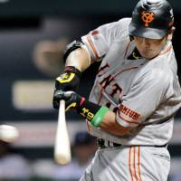 Potent production: Giants star Shinnosuke Abe hits a run-scoring single to center in the second inning, giving the Central League a lead it would not relinquish in Friday's All-Star Series Game 1 at Yahoo Dome. The CL won 4-1. | KYODO PHOTO