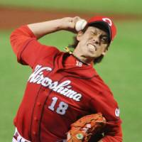 Memorable accomplishment: Carp hurler Kenta Maeda, a first-time All-Star, earns the victory by pitching two scoreless innings on Friday.