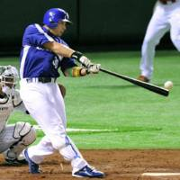 Big contributions: The Dragons' Masahiko Morino (above) goes 4-for-5 for the triumphant Central League All-Star squad and Tigers closer Kyuji Fujikawa strikes out the side in the ninth inning on Friday.