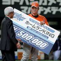 Paid in full: Tigers catcher Kenji Johjima receives a nice bonus for winning the NPB All-Star home run derby on Friday at Yahoo Dome. KYODO PHOTOS