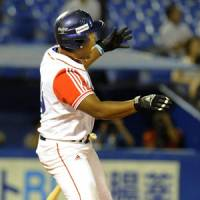 Clutch blast: Cuba's Alfredo Despaigne watches his game-ending three-run home run leave the yard in the 10th inning against the United States on Saturday in the 5th World University Baseball Championship's title game at Jingu Stadium. Cuba beat the U.S. 4-3. | KYODO PHOTO