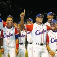 Thrill of victory: Cuba celebrates its dramatic triumph against the United States on Saturday at Jingu Stadium. | KYODO PHOTO