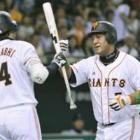 On-field camaraderie: Giants veteran Yoshinobu Takahashi congratulates Alex Ramirez after the slugger's solo home run in the fourth inning against the BayStars on Saturday at Tokyo Dome. Yomiuri defeated Yokohama 5-2. | KYODO PHOTO