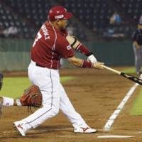 Textbook swing: Eagles slugger Takeshi Yamasaki smacks a two-out homer in the third inning against the Buffaloes at Skymark Stadium on Thursday. Orix beat Tohoku Rakuten 6-5. | KYODO PHOTO