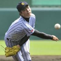 A dirty dozen: Tokaidai Sagami hurler Yosuke Shimabukuro fans 12 batters in the National High School Baseball Championship semifinals on Friday at Koshien Stadium. Tokaidai Sagami defeated Chiba Narita 11-7. | KYODO PHOTO