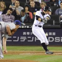 The hits keep coming: Ichiro Suzuki hits a single during the first inning of the Mariners' game against the Rangers on Saturday. The hit was the 3,500th of his career. | KYODO PHOTO