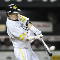 Flying start: Softbank's Hitoshi Tamura hits a three-run homer in the first inning on Sunday. | KYODO PHOTO