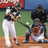 Historic hit: Marines star Tsuyoshi Nishioka laces a fourth-inning single, his 200th hit of the season, against the Buffaloes on Saturday at Kyocera Dome. He is the fifth player in Nippon Professional Baseball history to accomplish the feat. | KYODO PHOTO
