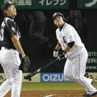 Memorable at-bat: Lions slugger Takeya Nakamura hits a solo home run in the second inning of the Pacific League Climax Series first stage opener on Saturday. | KYODO PHOTO