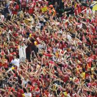 Sea of red: Fukuoka Softbank Hawks fans don red T-shirts to show their support for the Pacific League regular-season champions on Thursday at Yahoo Dome. | KYODO PHOTO