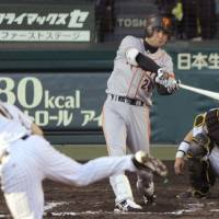 That winning touch: Giants veteran Yoshinobu Takahashi hits a two-run homer in the seventh inning off Tigers pitcher Tomoyuki Kubota during Game 2 of the Central League Climax Series first stage. | KYODO PHOTO