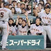 Total team effort: Role players and stars, including Alex Ramirez (5), made key contributions for the Yomiuri Giants during the first stage of the Central League Climax Series. | KYODO PHOTO