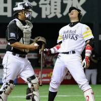 Not my night: Softbank's Hiroki Kokubo reacts after striking out in the eighth inning in Game 5 of the Pacific League Climax Series against the Chiba Lotte Marines on Monday. | KYODO PHOTO