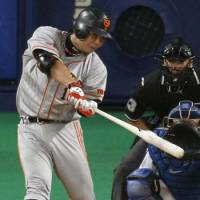 Resilient leader: Giants star Shinnosuke Abe hits a go-ahead solo home run in the ninth inning in Game 3 of the Central League Climax Series final stage on Friday at Nagoya Dome. Yomiuri beat Chunichi 3-2. | KYODO PHOTOS