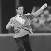 Historic figure: Masanori 'Mashi' Murakami throws out the first pitch on Masanori Murakami Night in August 1995 at Candlestick Park in San Francisco. Murakami, a pitcher who played for the Giants in 1964-65, was the first Japanese to play in the major leagues. | KYODO PHOTO