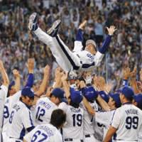 What a feeling: The Chunichi Dragons give manager Hiromitsu Ochiai a traditional doage after winning the Central League Climax Series championship on Saturday in Nagoya. | KYODO PHOTO