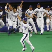 Aged like a fine wine: Kazuhiro Wada's series-clinching hit in the ninth inning capped a productive night for four of the Dragons' oldest players on Saturday. | KYODO PHOTO