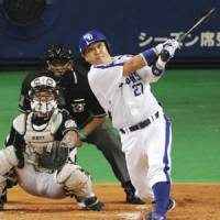 Display of power: Dragons catcher Motonobu Tanishige smacks a second-inning home run off Marines pitcher Yoshihisa Naruse on Saturday. | KYODO PHOTO