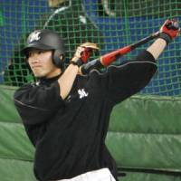 Serious business: Chiba Lotte's Tsuyoshi Nishioka, seen taking batting practice on Friday at Nagoya Dome, says maintaining the same focus during the Japan Series as he does during the regular season is important. | KYODO PHOTO