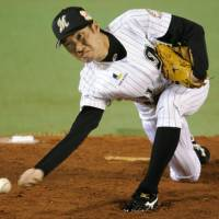 Slaying the Dragons: Marines right-hander Shunsuke Watanabe works nine effective innings in Chiba Lotte's 7-1 win in Game 3 of the Japan Series on Tuesday.