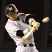 Special rookie: Chiba Lotte's Ikuhiro Kiyota hits a three-run triple in the fourth inning in Game 3 of the Japan Series on Tuesday. | KYODO PHOTO