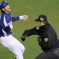 Almost knocked out: Dragons outfielder Hidenori Kurmamoto is called out at first base by the umpire in the fifth inning as the Chiba Lotte Marines move a game away from winning the Japan Series over Chunichi. | KYODO PHOTOS