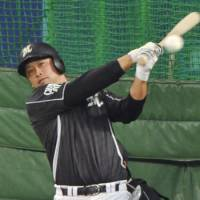 Back to work: Chiba Lotte's Ikuhiro Kiyota swings the his bat during Friday's practice at Nagoya Dome. The rookie has been a key factor for the Marines during the Japan Series.