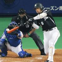 Big time player: Marines third baseman Toshiaki Imae hits an RBI single during third inning of the opening game of the Japan Series on Oct. 30 in Nagoya. | KYODO PHOTO