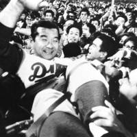 A hero to many: Former Chunichi Dragons manager Wally Yonamine, seen celebrating with fans after the team's 1974 Central League pennant win, was a popular figure for decades. | KYODO PHOTO