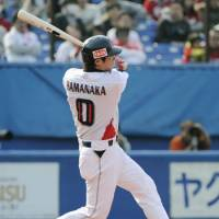 Back in action: Tokyo Yakult's Osamu Hamanaka smacks a seventh-inning solo home run in the Swallows' 3-0 win over the Hiroshima Carp on Saturday at Jingu Stadium. | KYODO PHOTO