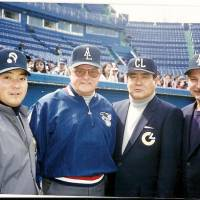 Joint effort: American and Japanese umpires taking part in the first U.S.-Japan exchange at Tokyo's Jingu Stadium in March of 1996. From left: Takeshi Hirabayashi of the Pacific League, Don Denkinger of the American League, Toshiyuki Tanaka of the Central League and AL arbiter Jim Evans. | WAYNE GRACZYK PHOTO