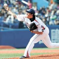 High flyer: Tokyo Yakult's Tatsuyoshi Masubuchi throws a pitch against the BayStars on Sunday. Masubuchi allowed just one hit over eight innings as the Swallows won 4-0. | KYODO