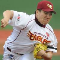 Look of determination: Eagles right-hander Masahiro Tanaka guides Tohoku Rakuten to an emotional 3-1 victory over the Orix Buffaloes on Friday in Sendai. | KYODO PHOTOS