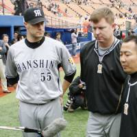 Uneasy feeling: Alabama natives Jason Standridge, left, and Craig Brazell discuss the situation in their home state on Saturday in Yokohama. | KYODO