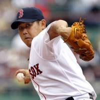A win's a win: Red Sox starter Daisuke Matsuzaka throws a pitch against the Twins on Sunday in Boston. Matsuzaka earned the win in the Red Sox's 9-5 triumph despite allowing four runs in six innings. | KYODO PHOTO