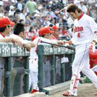 That frustrating feeling: Carp slugger Kenta Kurihara walks back to the dugout after striking out in the eighth inning on Saturday against the Buffaloes at Mazda Stadium. Orix handed Hiroshima its eighth straight defeat, winning 5-2. | KYODO PHOTO