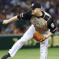 Steady performer: Brian Wolfe, who once teamed with reigning National League Cy Young Award winner Roy Halladay, has been a key part of the Hokkaido Nippon Ham Fighters' success this season. | KYODO