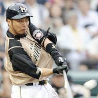 Ticket to ride: Fighters slugger Sho Nakata bashes a two-run home run in the eighth inning against the Carp on Saturday at Mazda Stadium. Hokkaido Nippon Ham routed Hiroshima 9-1. | KYODO PHOTO