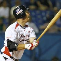 Big blast: Swallows slugger Josh Whitesell watches his 10th-inning walk-off home run leave the yard on Friday. Tokyo Yakult beat Yokohama 2-1. | KYODO PHOTO